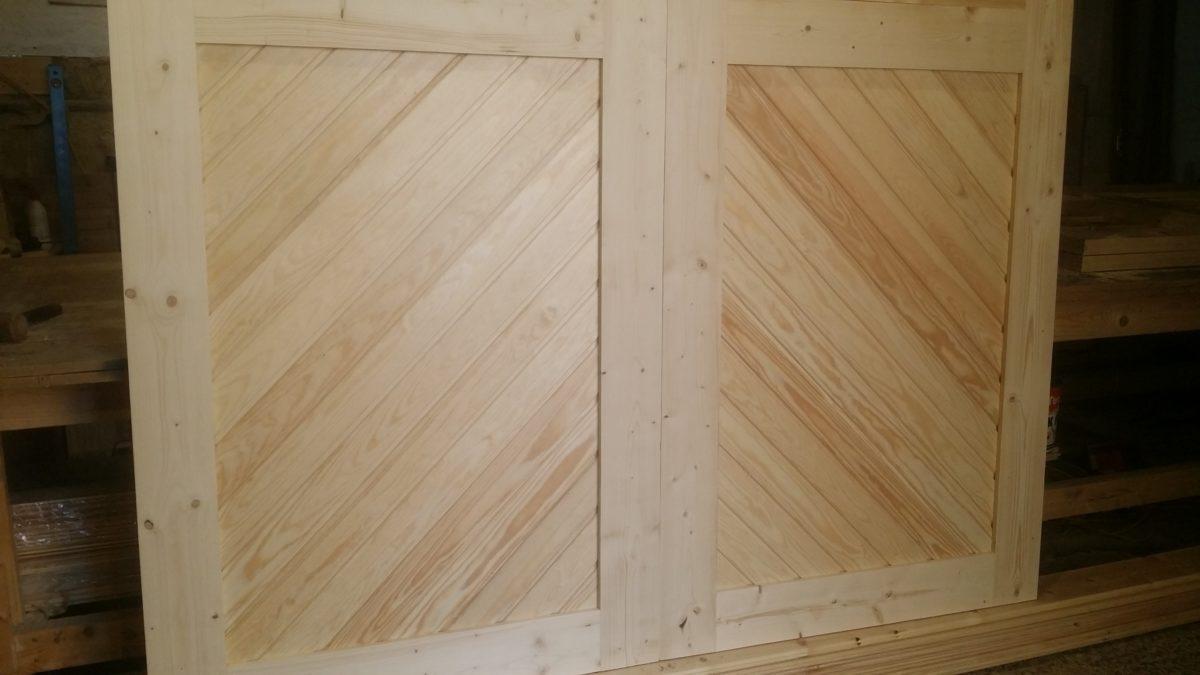 Diagonal Cladding with Windows Timber Garage Doors